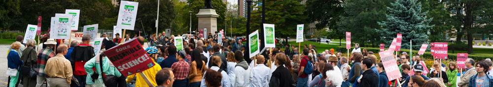 Protesters call for increased funding of science research at Queen's Park rally