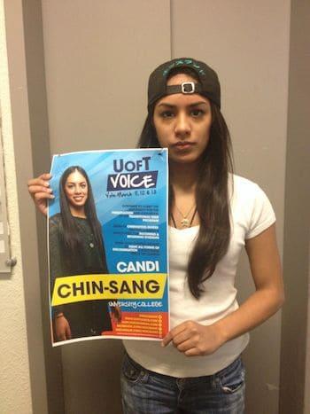 Candi Chin-Sang holding one of posters she says misrepresented her platform. SARAH NIEDOBA/THE VARSITY