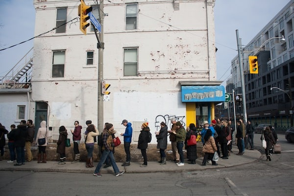 The lineup for the signs stretched around the block. CAROLYN LEVETT/THE VARSITY