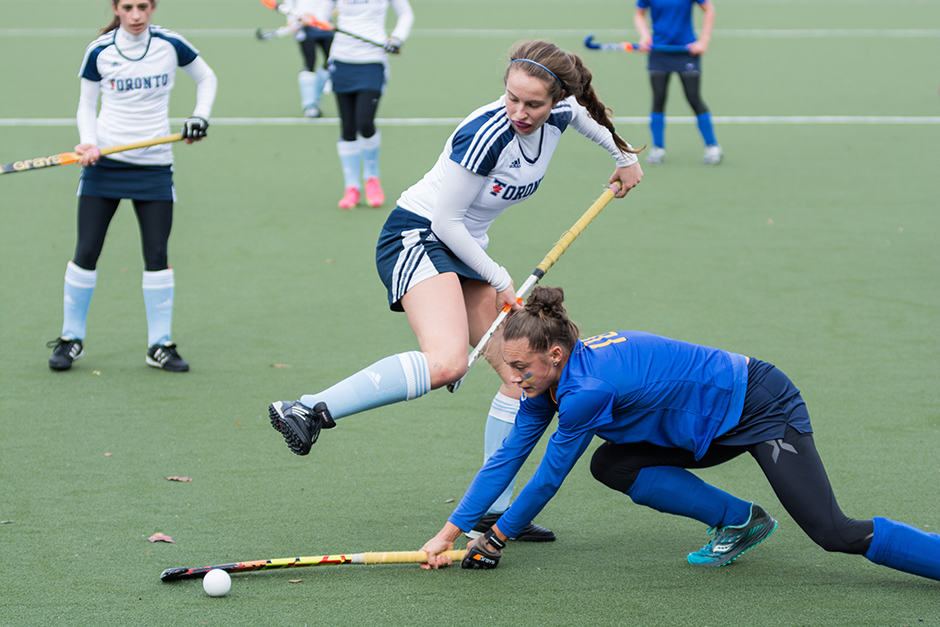 Blues athlete fights for possession of the ball.