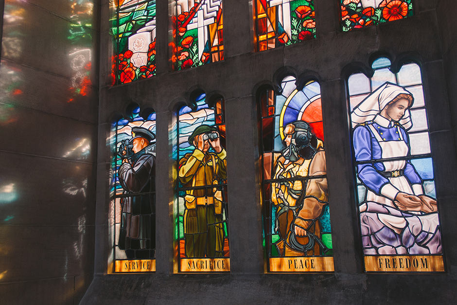 The lower panels of the Memorial Window depict the men and women of the services: a sailor, a soldier, an airman, and a nurse. JENNIFER SU/THE VARSITY