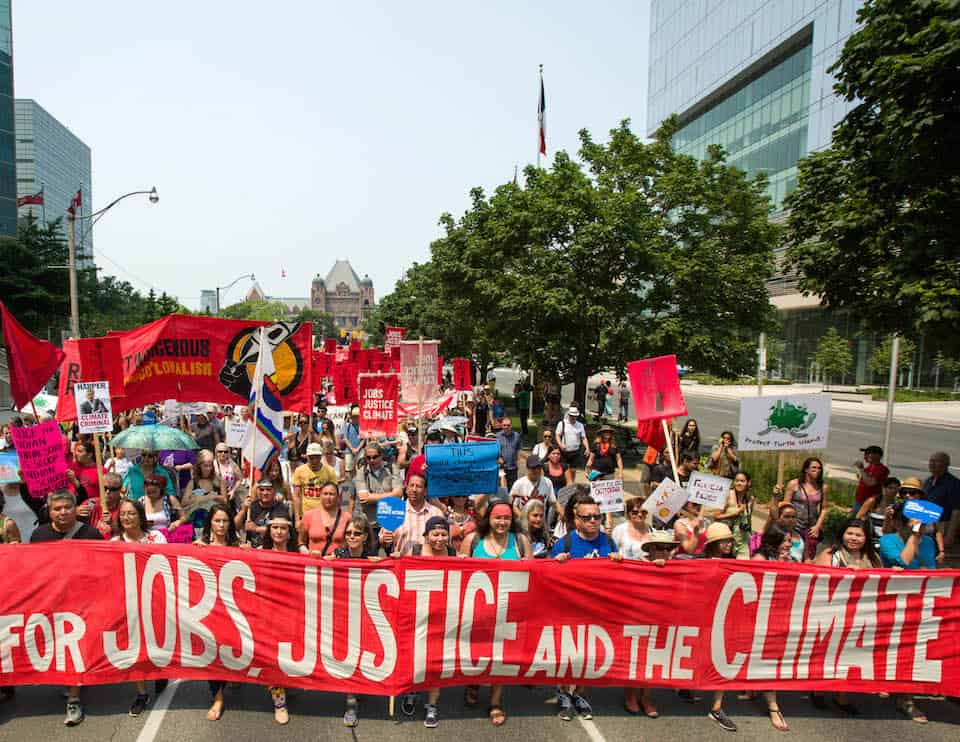 #JobsJusticeClimate March in Toronto on July 5th, 2015. by Robert van Waarden is licensed under CC BY 2.0  