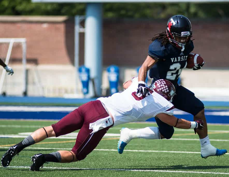 Blues fall to Marauders in football home opener