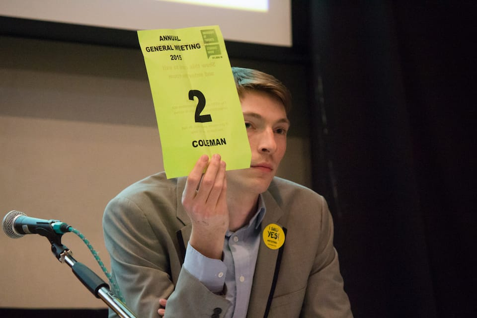 UTSU president Ben Coleman voting for a motion at the 2015 AGM. Mallika Makkar/THE VARSITY