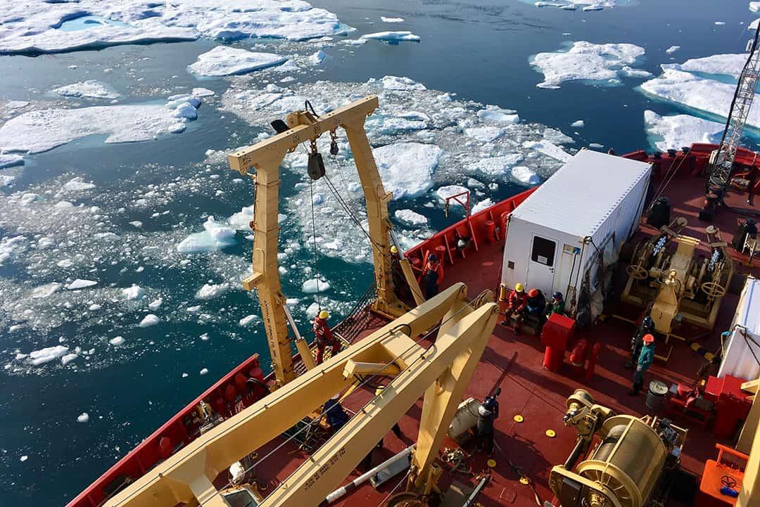 Scientists work on deck aboard the Amundsen. CLARA THAYSEN/THE VARSITY