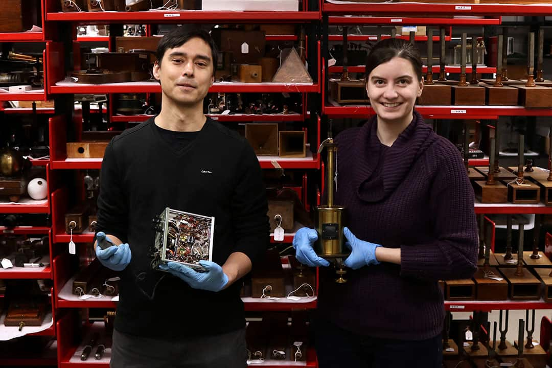 Erich Weidenhammer and Victoria Fisher are working to catalogue a collection of scientific artifacts. COURTESY OF UTSIC.