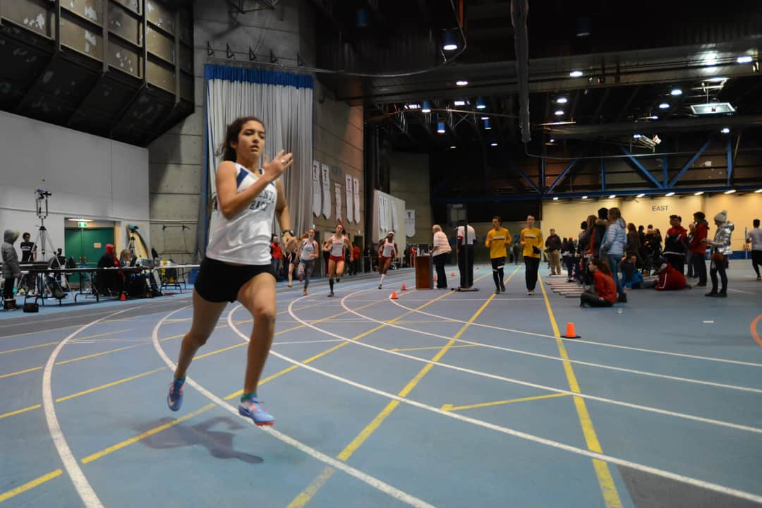 Carolyn Solek running in the 300 metre event. STEVEN LEE/THE VARSITY