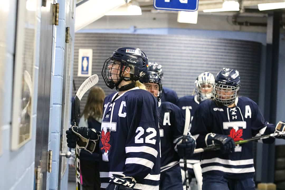 Blues ffth-year captain Becki Bowering leads the Blues back onto the ice for the start of second period. DANIEL SAMUEL/THE VARSITY