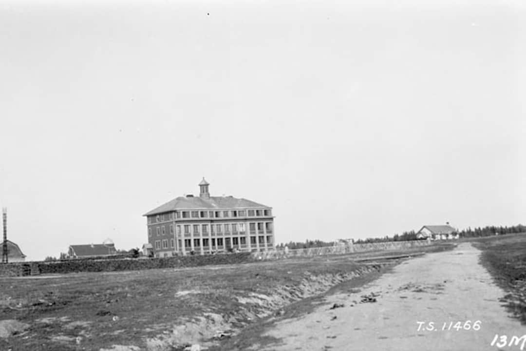 In Canada, the residential school system was a network of boarding schools for Indigenous peoples.   House Residential School, Manitoba  C.S. MACDONALD, DEPARTMENT OF MINES AND TECHNICAL SURVEYS LIBRARY AND ARCHIVES CANADA/CC FLICKR