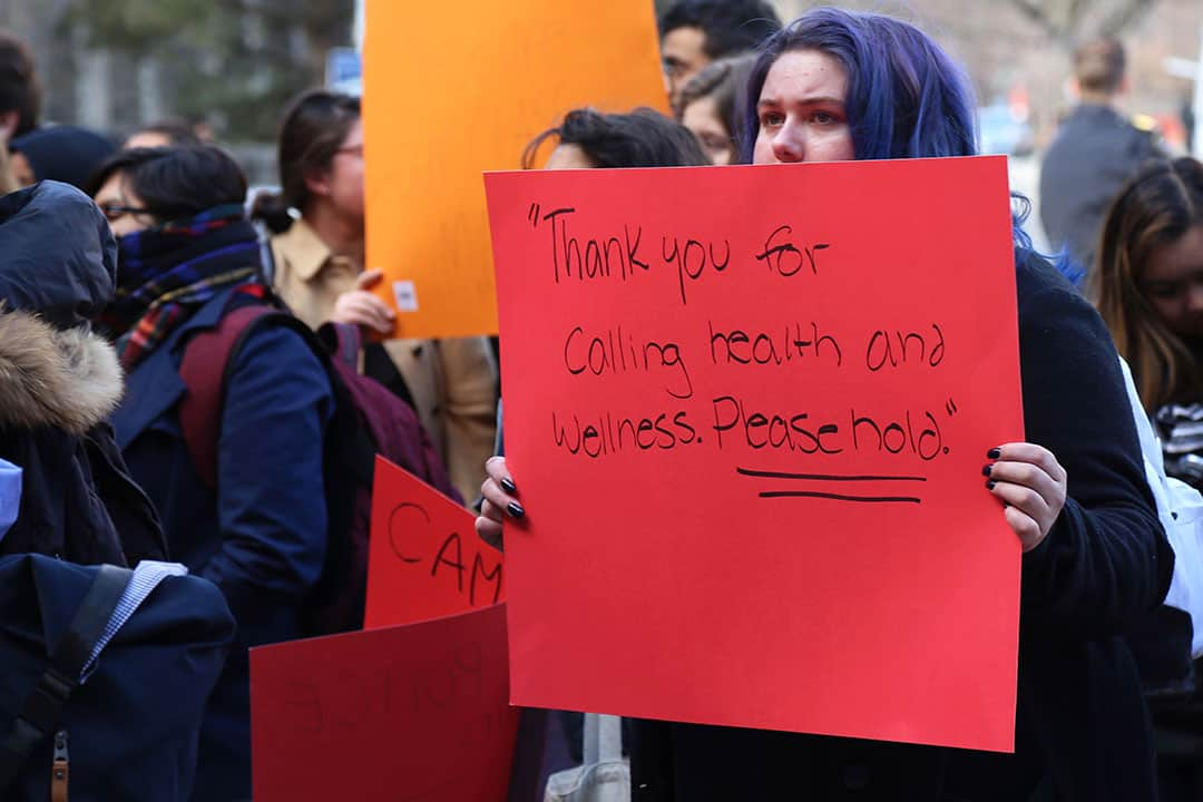 Students have protested multiple times outside of Simcoe Hall to call on Governing Council to improve on the percieved lack of mental health resources. SHANNA HUNTER/THE VARSITY