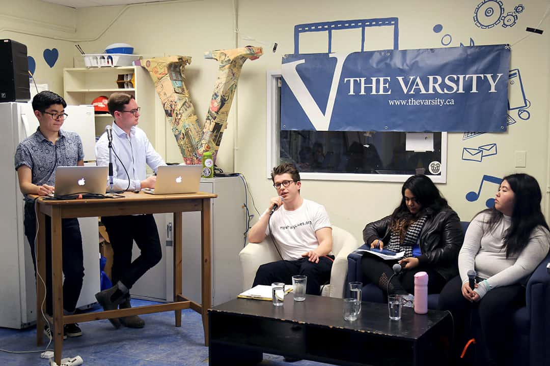 The Vice-President University Affairs candidates at the debate: Christopher Chiasson, Avani Singh, and Sharon Ma (seated, from left).  Shanna Hunter/THE VARSITY