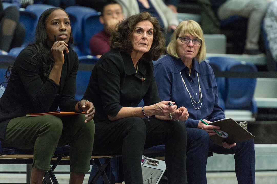 Michèle Bélanger, centre, has been the coach of the women's basketball team for 41 years. Courtesy of the VARSITY BLUES