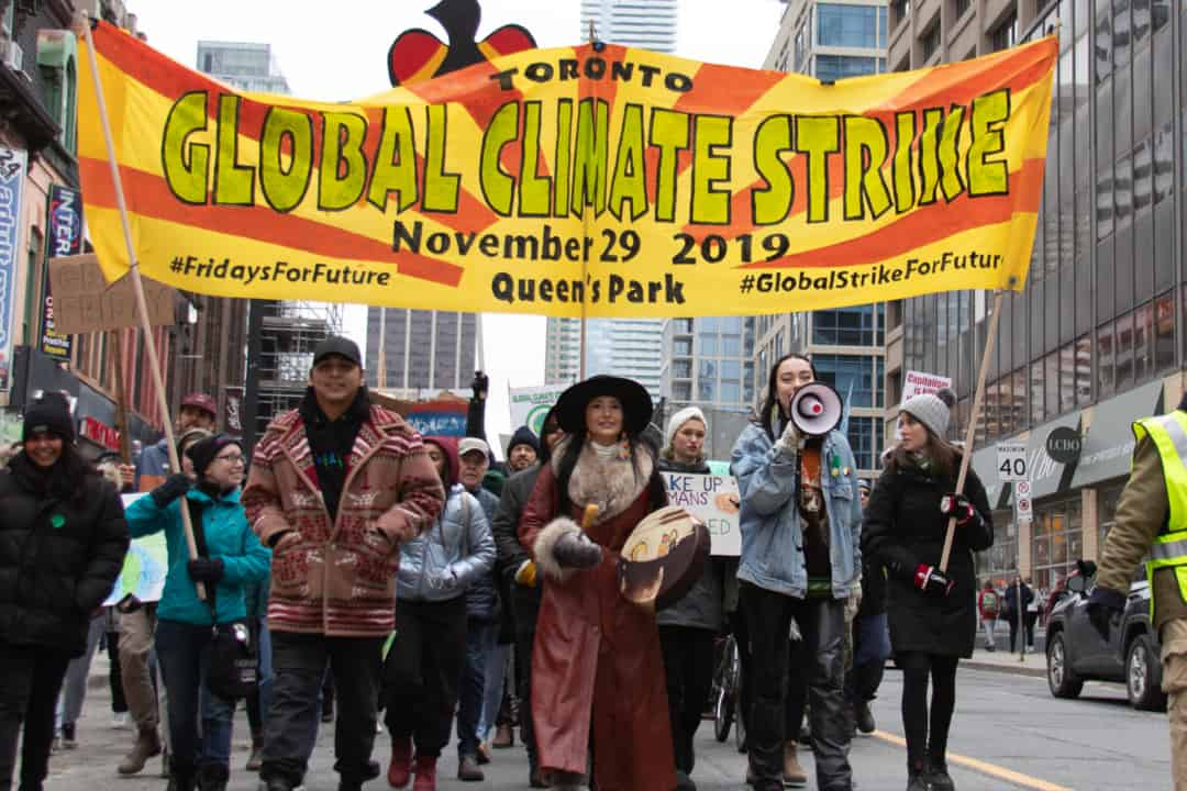Protestors call for climate action with Black Friday strike