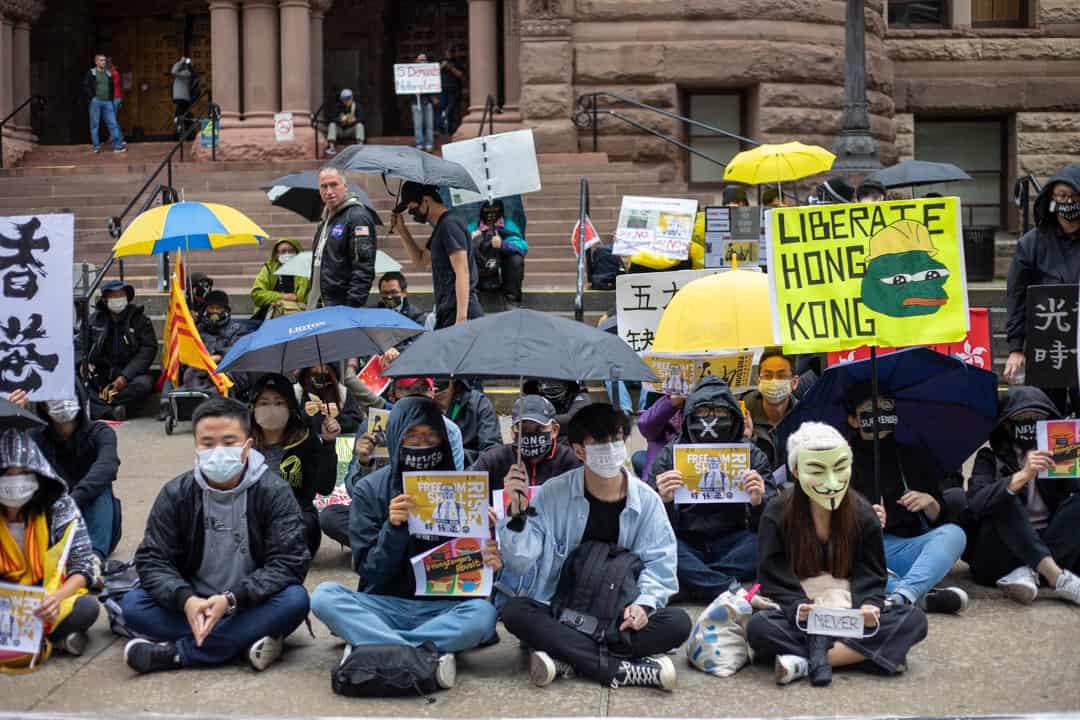 Pro-Hong Kong democracy activists at Queen's Park last fall. HANNAH CARTY/THE VARSITY